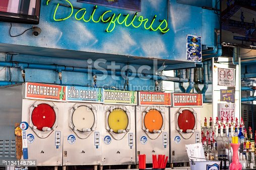 New Orleans, Louisiana / USA - February 14, 2019: Colorful frozen drinks for sale in the famous French Quarter, with familiar names like the New Orleans special, Hurricane drink.