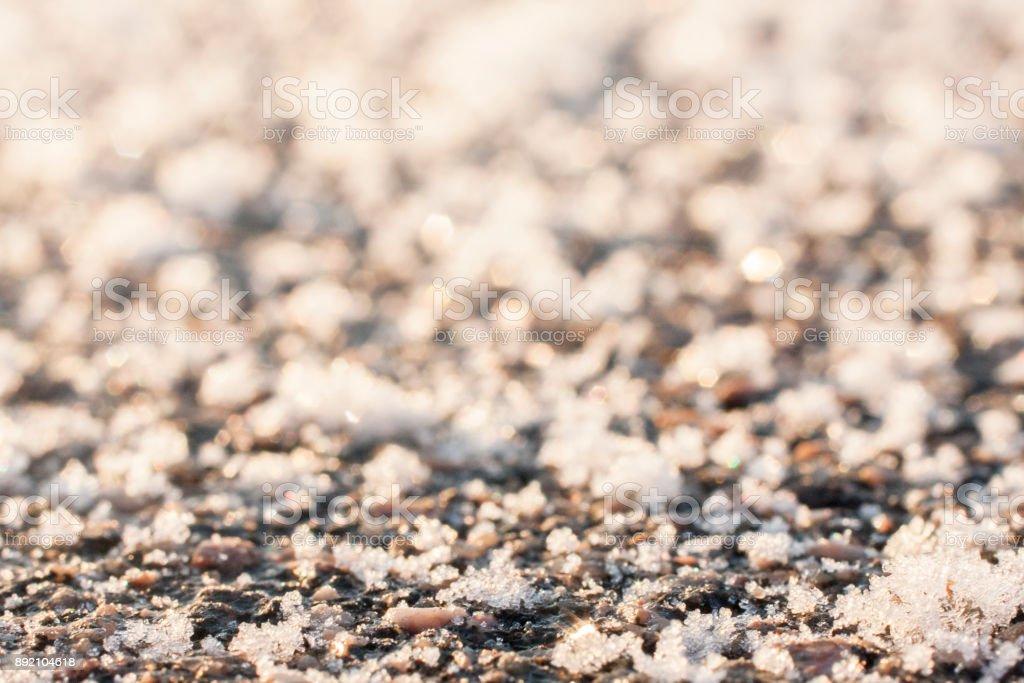 Frozen asphalt surface. stock photo