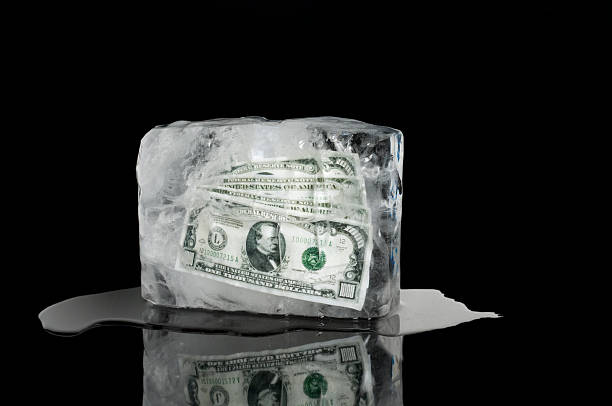 frozen assets - money black background stock photos and pictures