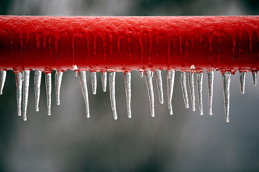 red frozen metal bar