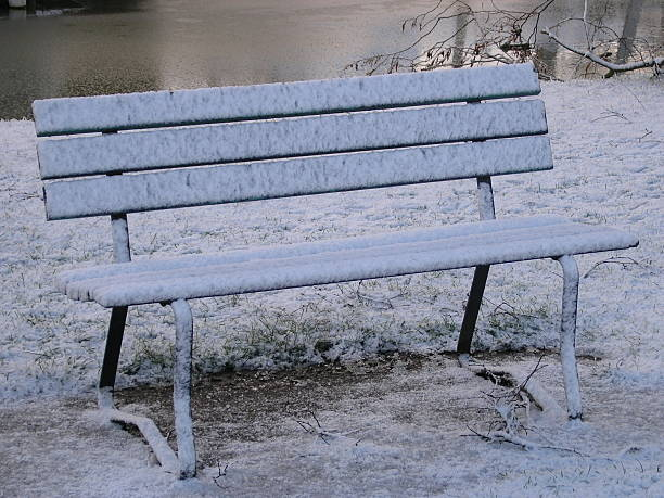 Frozen Bench A snow covered bench. skeable stock pictures, royalty-free photos & images