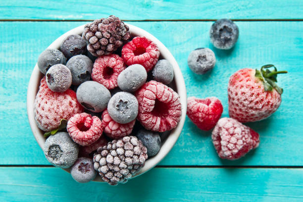 frozen berries in a bowl. various mix berry - frozen stock pictures, royalty-free photos & images