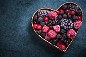 Frozen berries in heart symbol shape