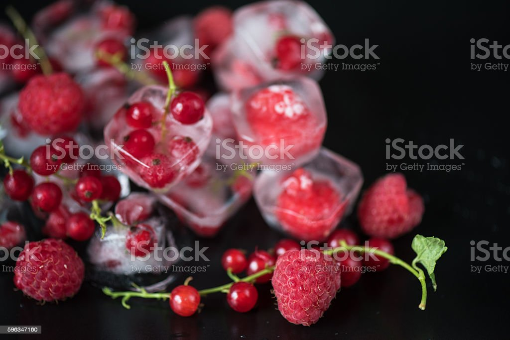 Frozen berries on wooden table royalty-free stock photo