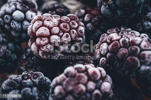 istock Frozen blackberry, macro, top view.Close up view on frozen Blackberry fruits 1127766876
