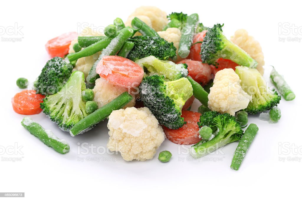 Frozen broccoli, carrots, peas, cauliflower, and green beans stock photo