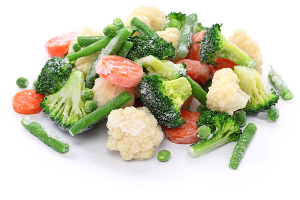 frozen broccoli, carrots, peas, cauliflower, and green beans - frozen stock photos and pictures