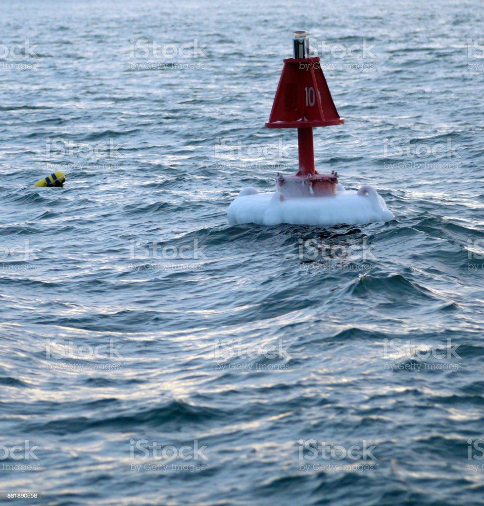 Frozen Buoy stock photo