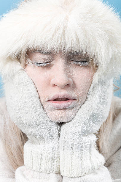 Frozen. Chilled female face covered in ice. stock photo