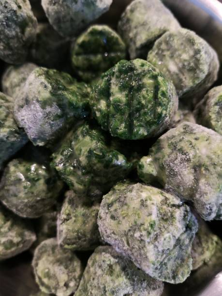 frozen defrost spinach cubes, tasty - defrost stock pictures, royalty-free photos & images