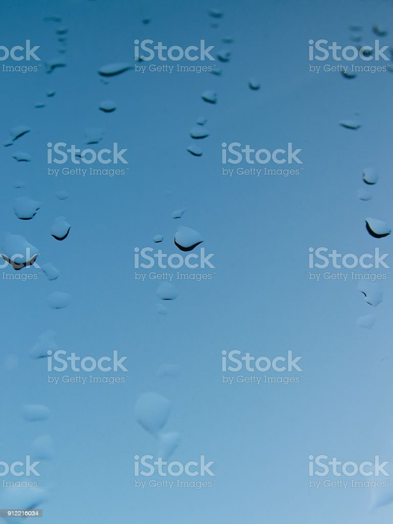 Frozen  drops on the glass stock photo