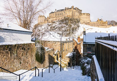 Edinburgh, Scotland - A snowy view from the Vennel, located near the Grassmarket in Edinburgh's Old Town, of the city's historic castle.