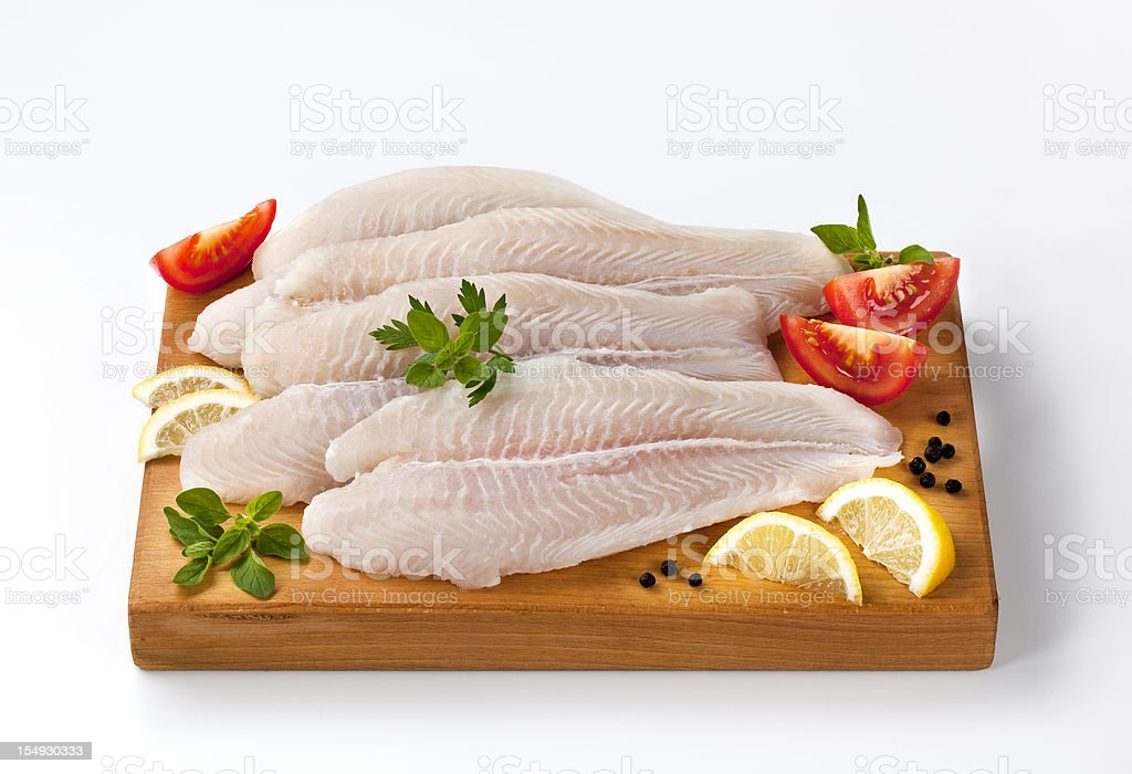 Frozen fish fillets on a cutting board royalty-free stock photo
