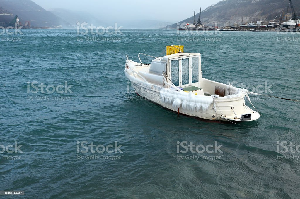 Frozen fishing boat royalty-free stock photo