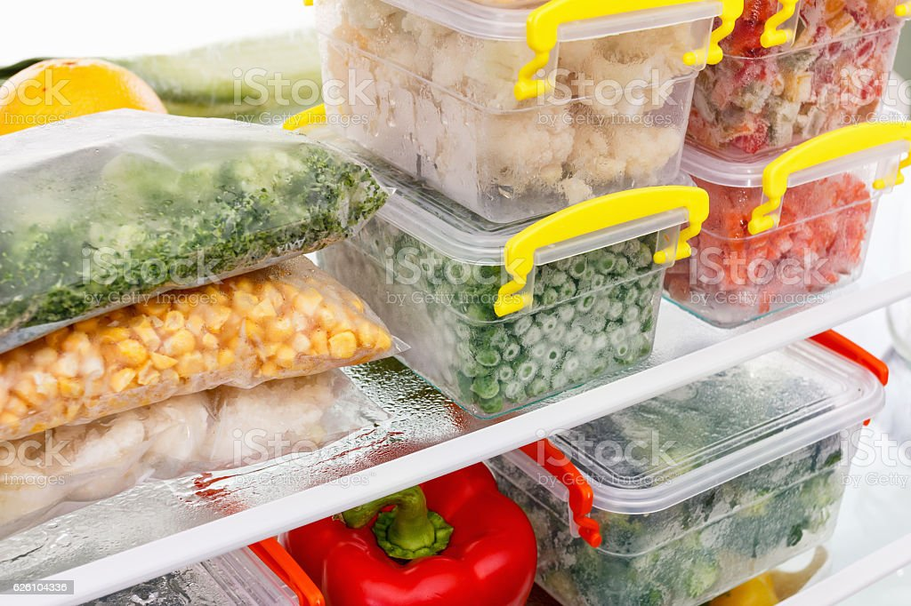 Frozen food in the refrigerator. Vegetables on the freezer shelves. royalty-free stock photo
