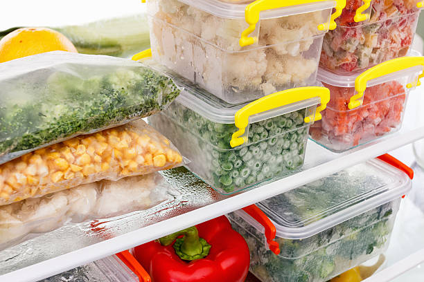 Frozen food in the refrigerator. Vegetables on the freezer shelves. stock photo