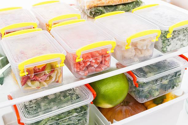 frozen food in the refrigerator. vegetables on the freezer shelves. - ローフード ストックフォトと画像