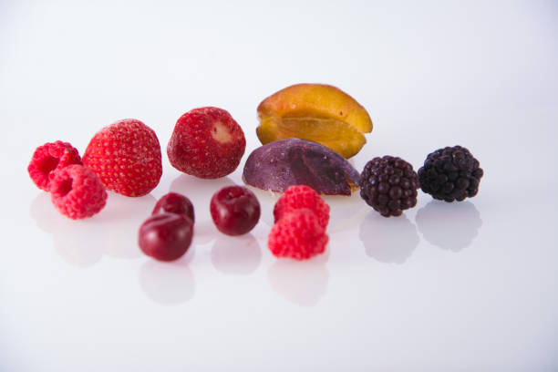 Frozen fruit on a white background stock photo