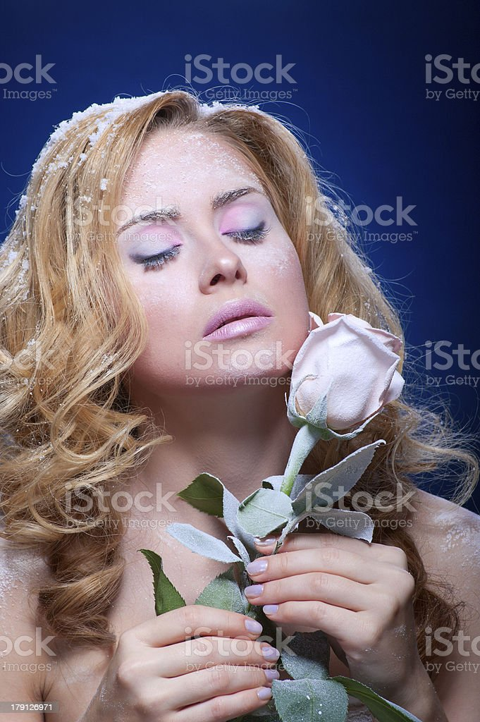 Frozen girl with rose flower royalty-free stock photo