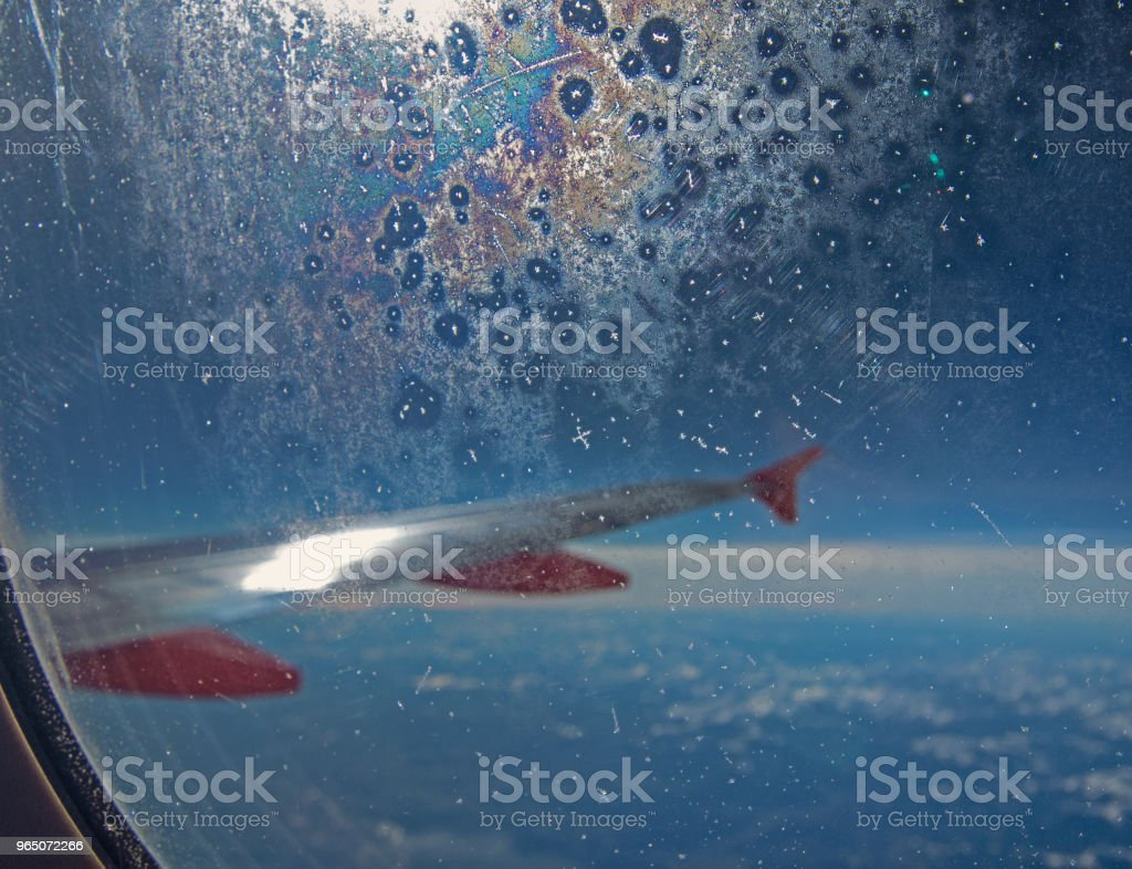 frozen glass of plane window at high altitude royalty-free stock photo