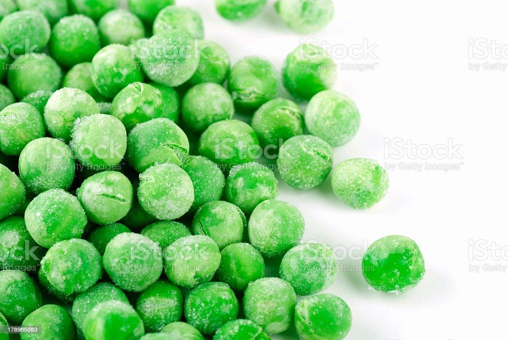 Frozen green peas, waiting to be cooked bildbanksfoto