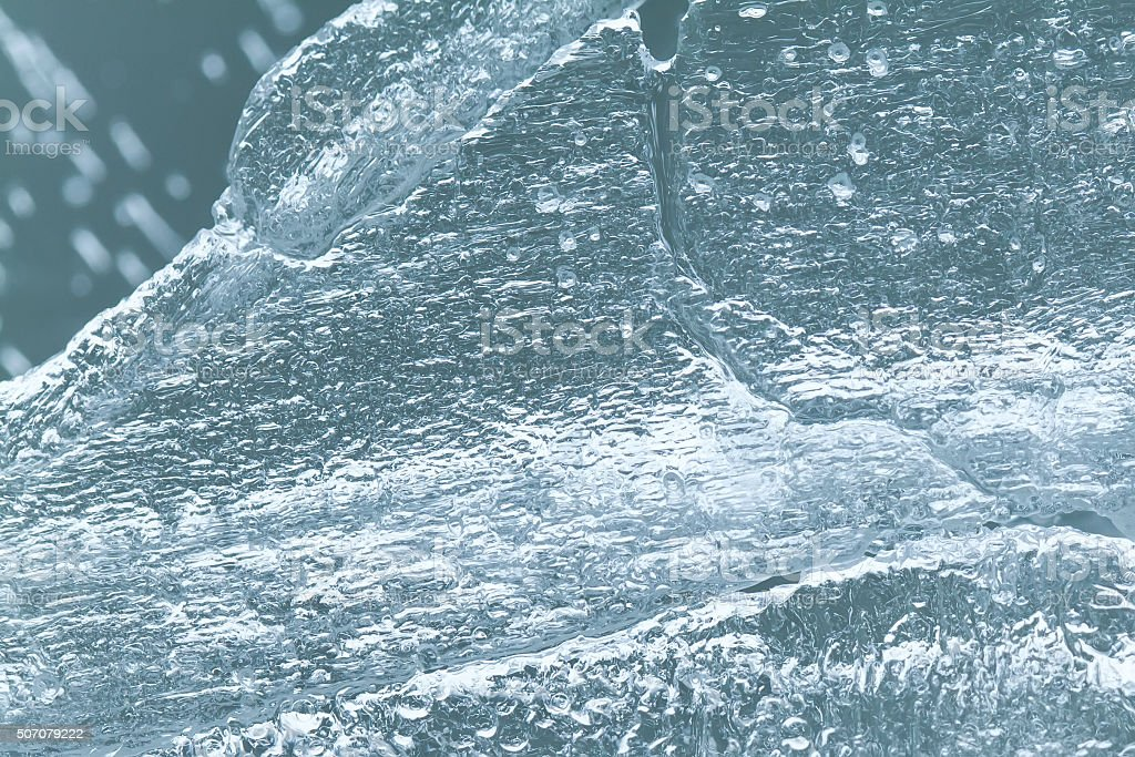 Frozen ice block texture, icy textured surface macro view, soft stock photo