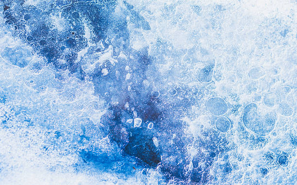 Frozen ice structure. Blue ice background. Winter icy backgrounds. stock photo