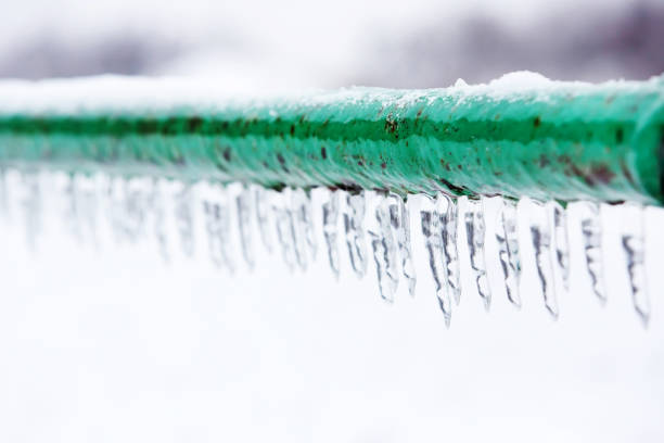 frozen icy down pipe - frozen stock pictures, royalty-free photos & images