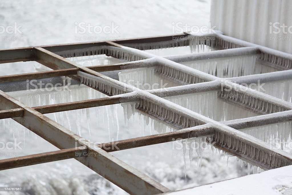 Frozen iron rungs with the white icicles in winter outdoors. royalty-free stock photo