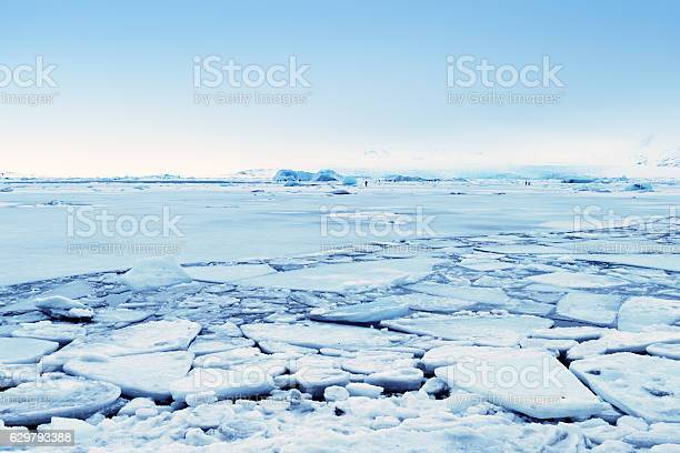 Photo of Frozen Jokulsarlon glacial lagoon in winter, Iceland