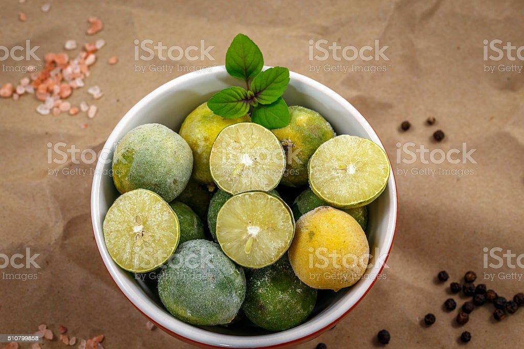 frozen key limes stock photo