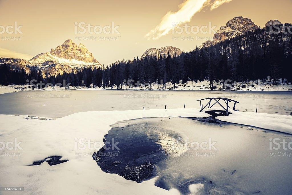 Frozen Lake and Dolomites Winter Landscape at Sunrise royalty-free stock photo