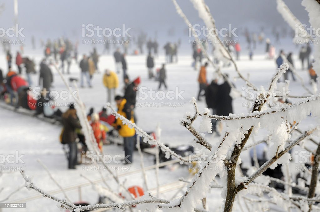 frozen lake and people on it stock photo