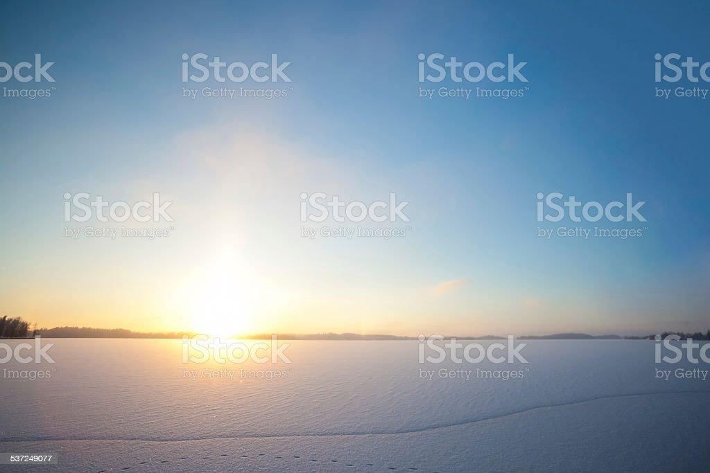 Frozen lake and sunset stock photo