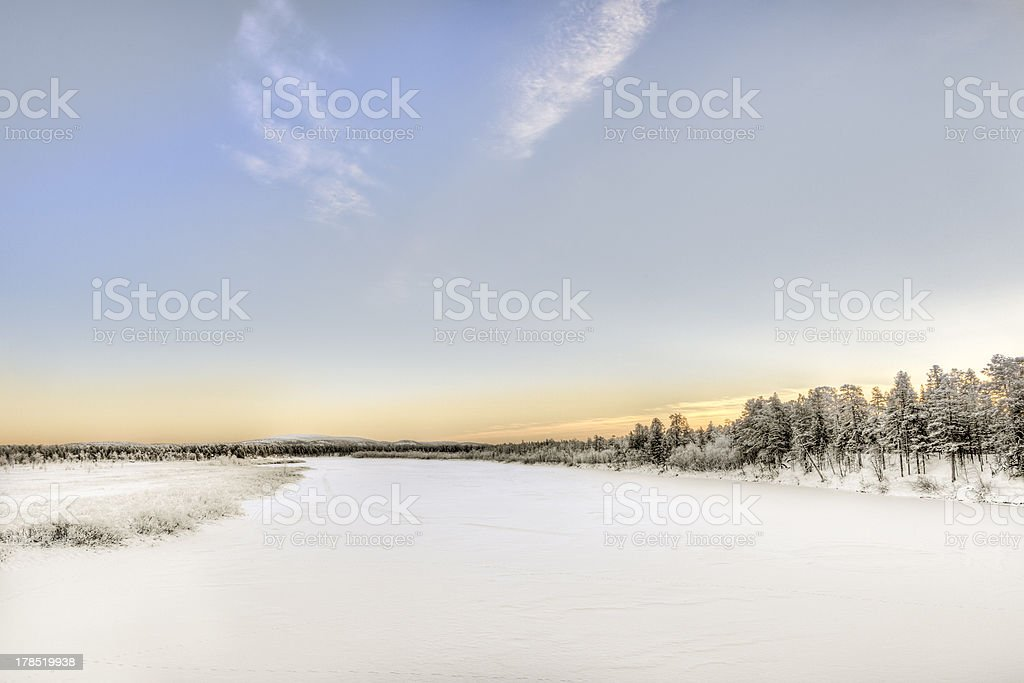 Frozen Lake at sunset in Inari, Lapland, Finland royalty-free stock photo