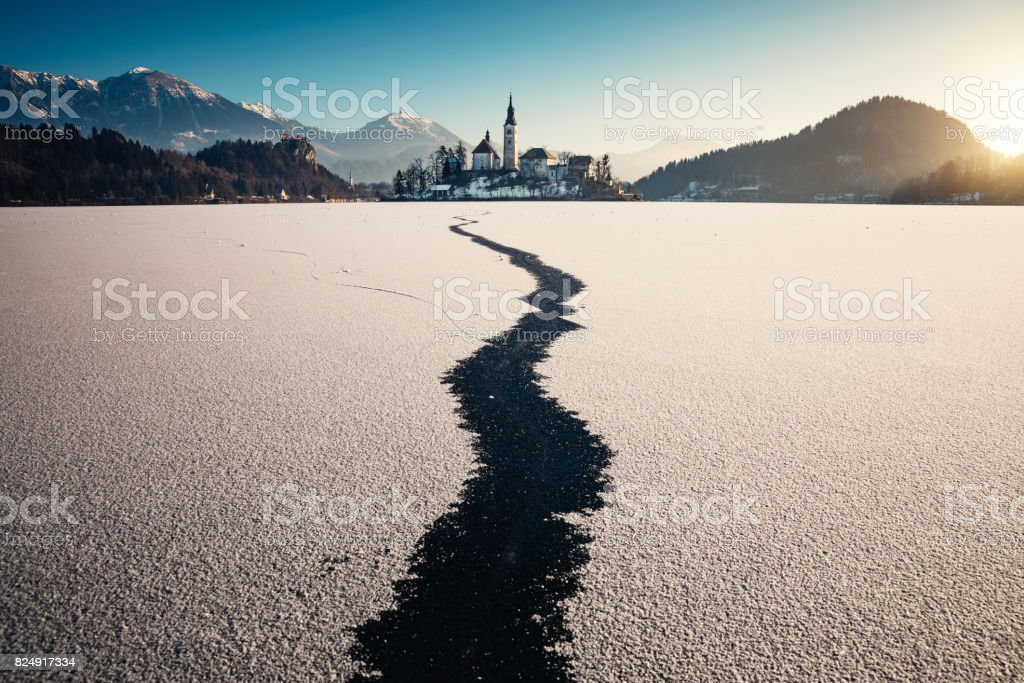 Frozen Lake Bled At Sunrise stock photo