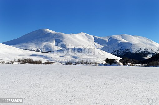 istock frozen lake during winter with snowy volcanic mountain 1197838528