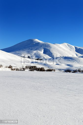 istock frozen lake during winter with snowy volcanic mountain 1197839029