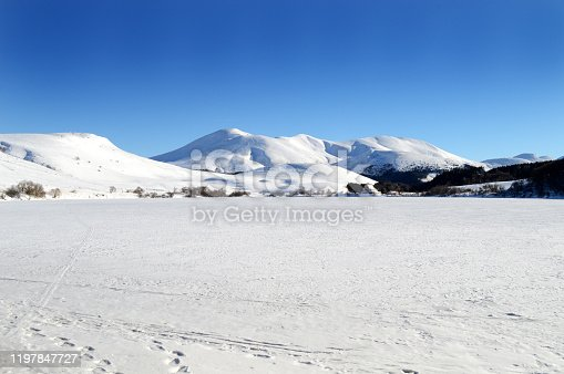 istock frozen lake during winter with snowy volcanic mountain 1197847727