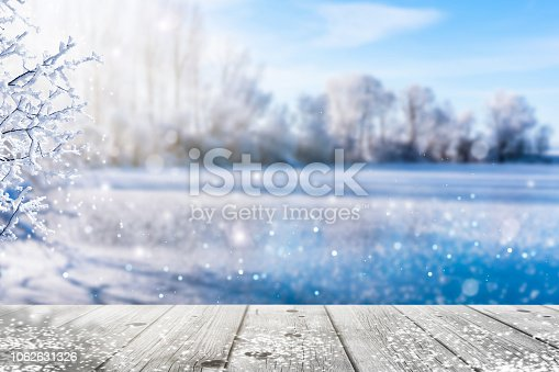 frozen lake in idyllic winter landscape