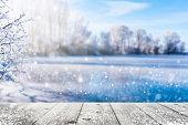 frozen lake in idyllic winter landscape
