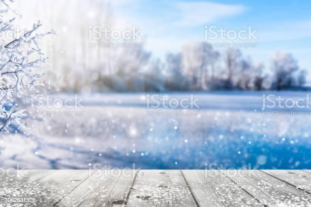 Photo of frozen lake in idyllic winter landscape