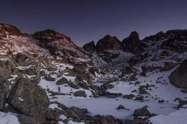 Frozen lake in Rila Mountains stock photo