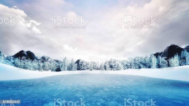 Photo of frozen lake in winter mountain landscape