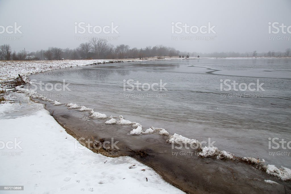 Frozen Lake In Winter stock photo
