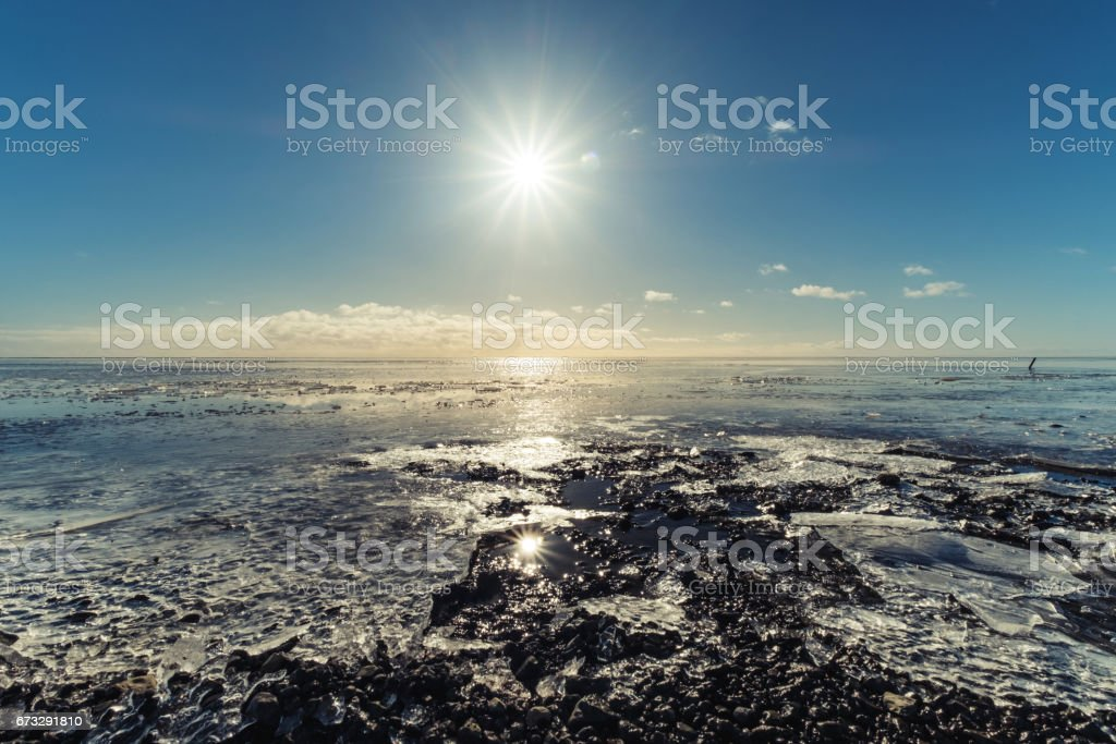 Frozen lake under shiny sun, winter landscaped royalty-free stock photo