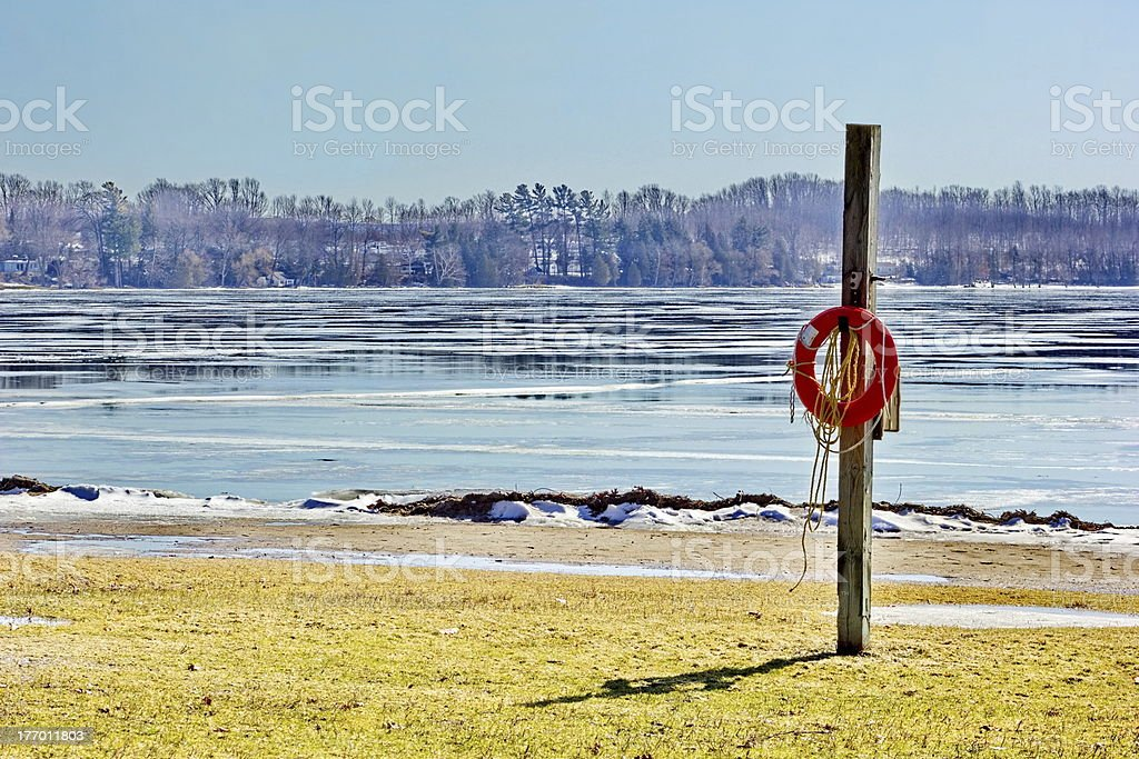 Frozen Lake with Hanging Life Ring stock photo