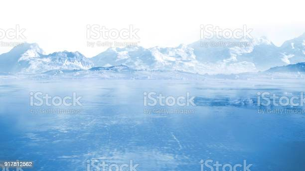 Photo of frozen lake with surrounding snow covered rocky mountains
