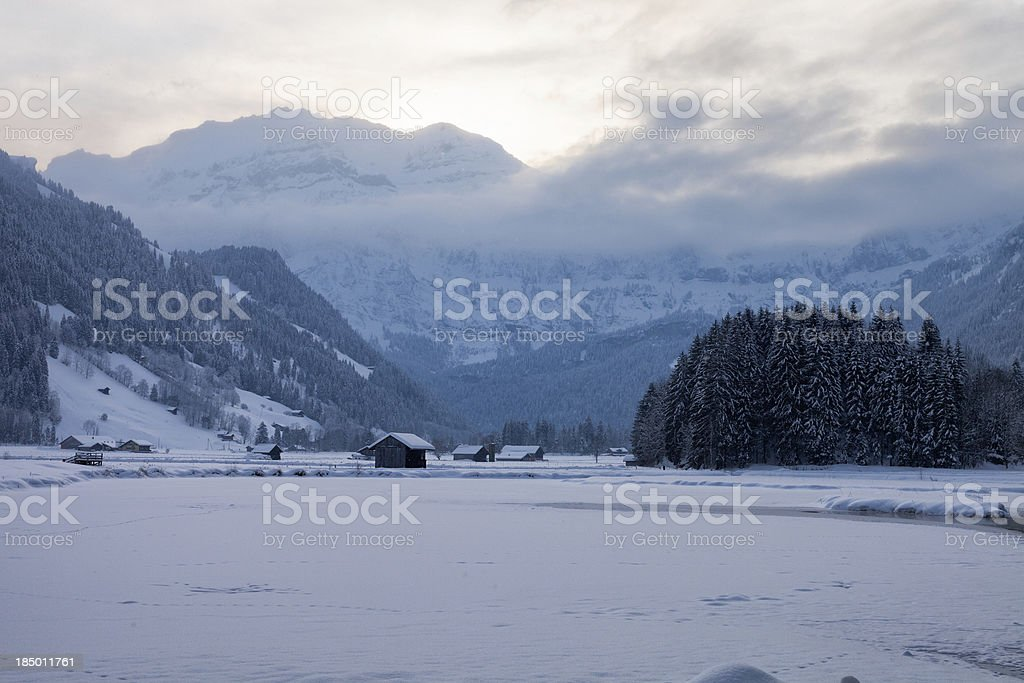 Frozen Lenkerseeli and Wildstrubel on Winter Morning stock photo