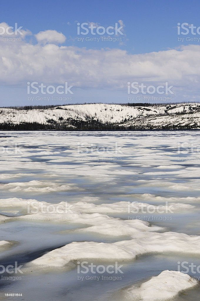 Frozen Lewis Lake in Yellowstone National Park Wyoming stock photo